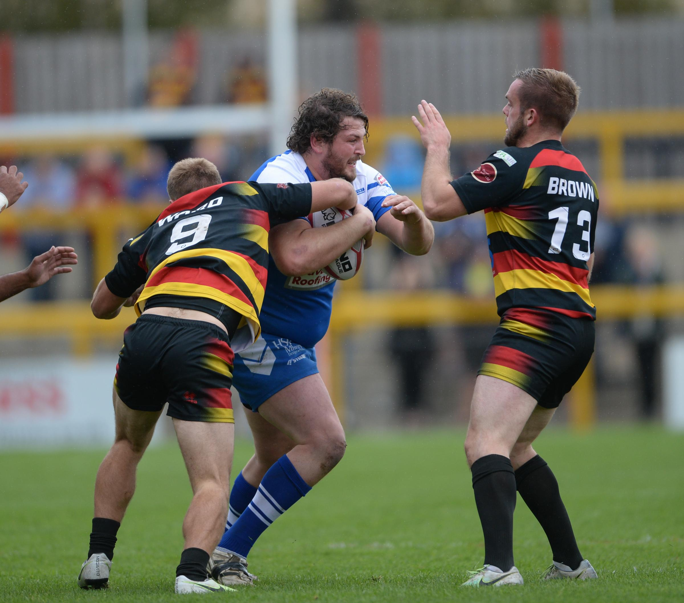 Aaron Brown joins in to stop Barrow Raiders' Ryan Duffy during his time with Dewsbury Rams Picture: Richard Land