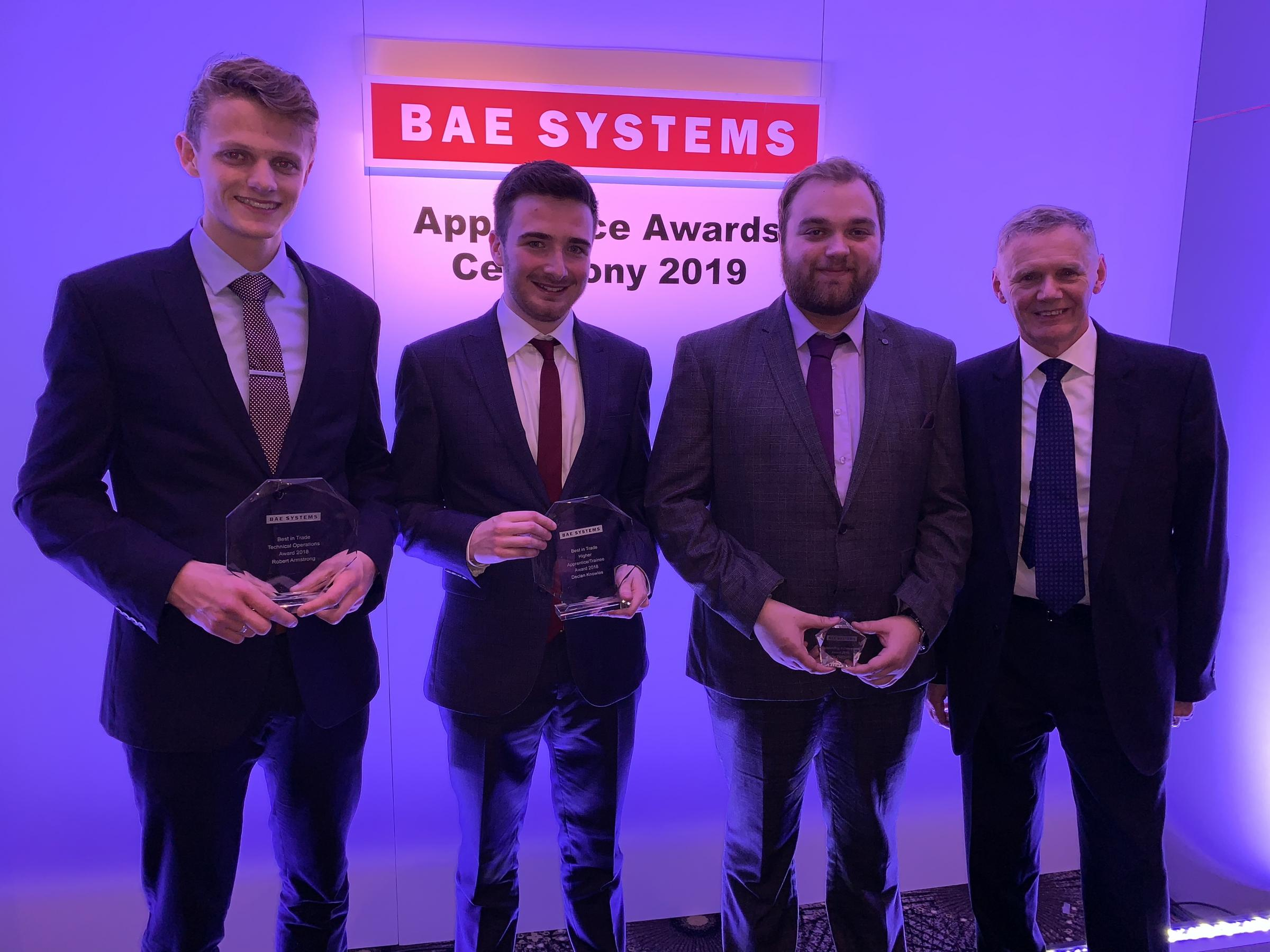 L-R: BAE apprentices Robert Armstrong, Declan Knowles and Jake Dewhurst with BAE Submarines managing director Cliff Robson.