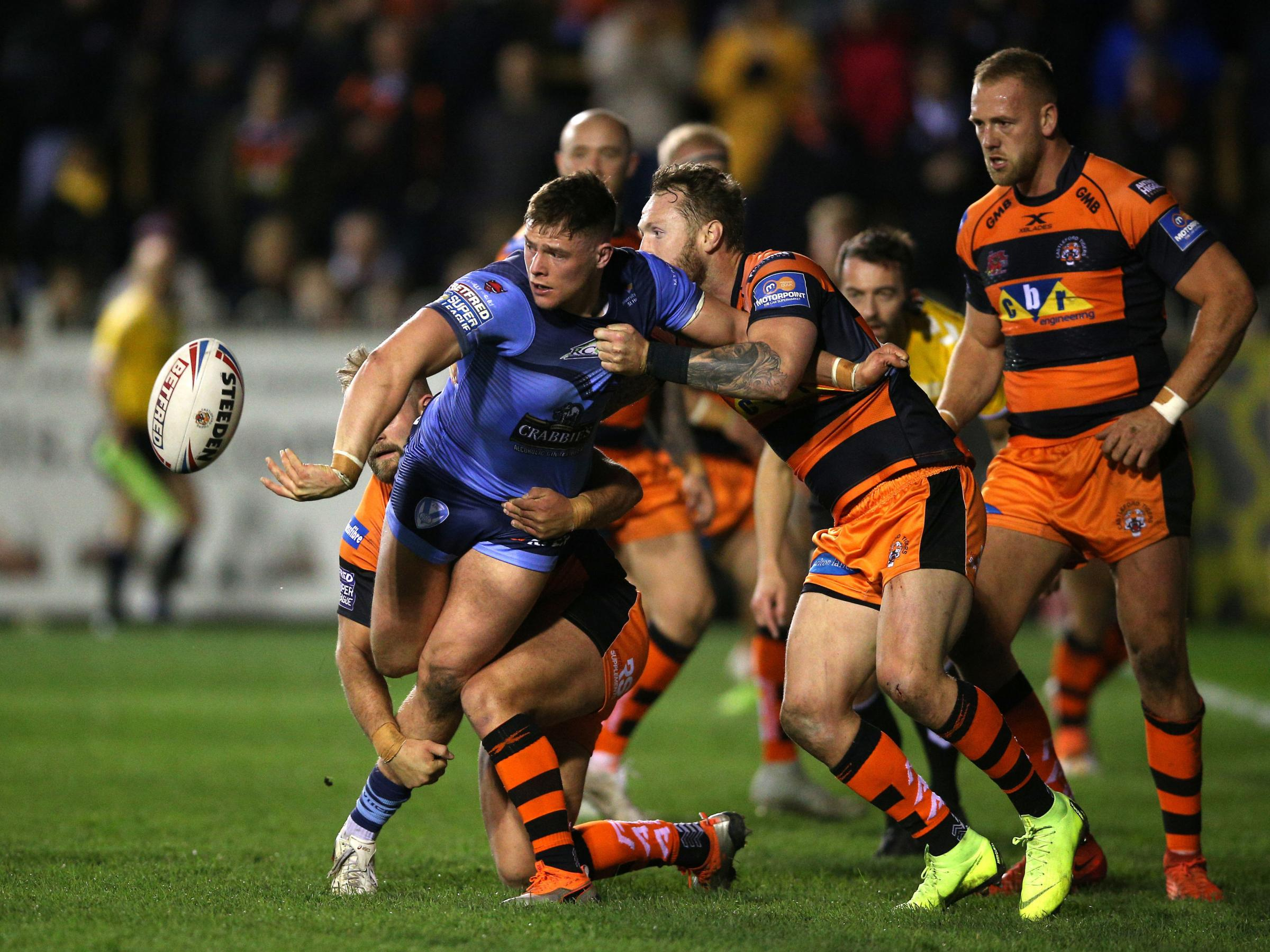 Morgan Knowles offloads during St Helens' 42-12 win away to Castleford Tigers Picture: PA
