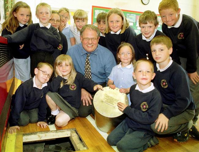 Heritage: Pupils with headteacher John Ireland and a time capsule to  be buried at Barrow Island Primary School in July 2000