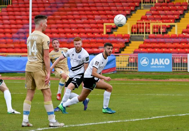 John Rooney bends in his second goal at Gateshead