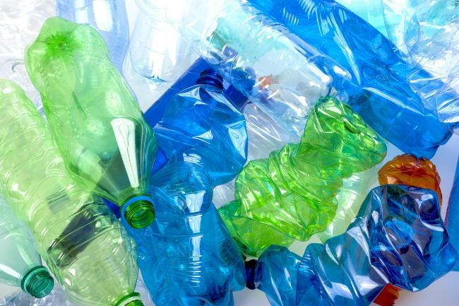 crushed multicolored plastic bottles  background.