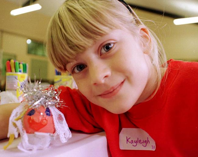 Art: Kayleigh with her painted egg at a September 1999 workshop for children  at St Luke's Church on Roose Road, Barrow