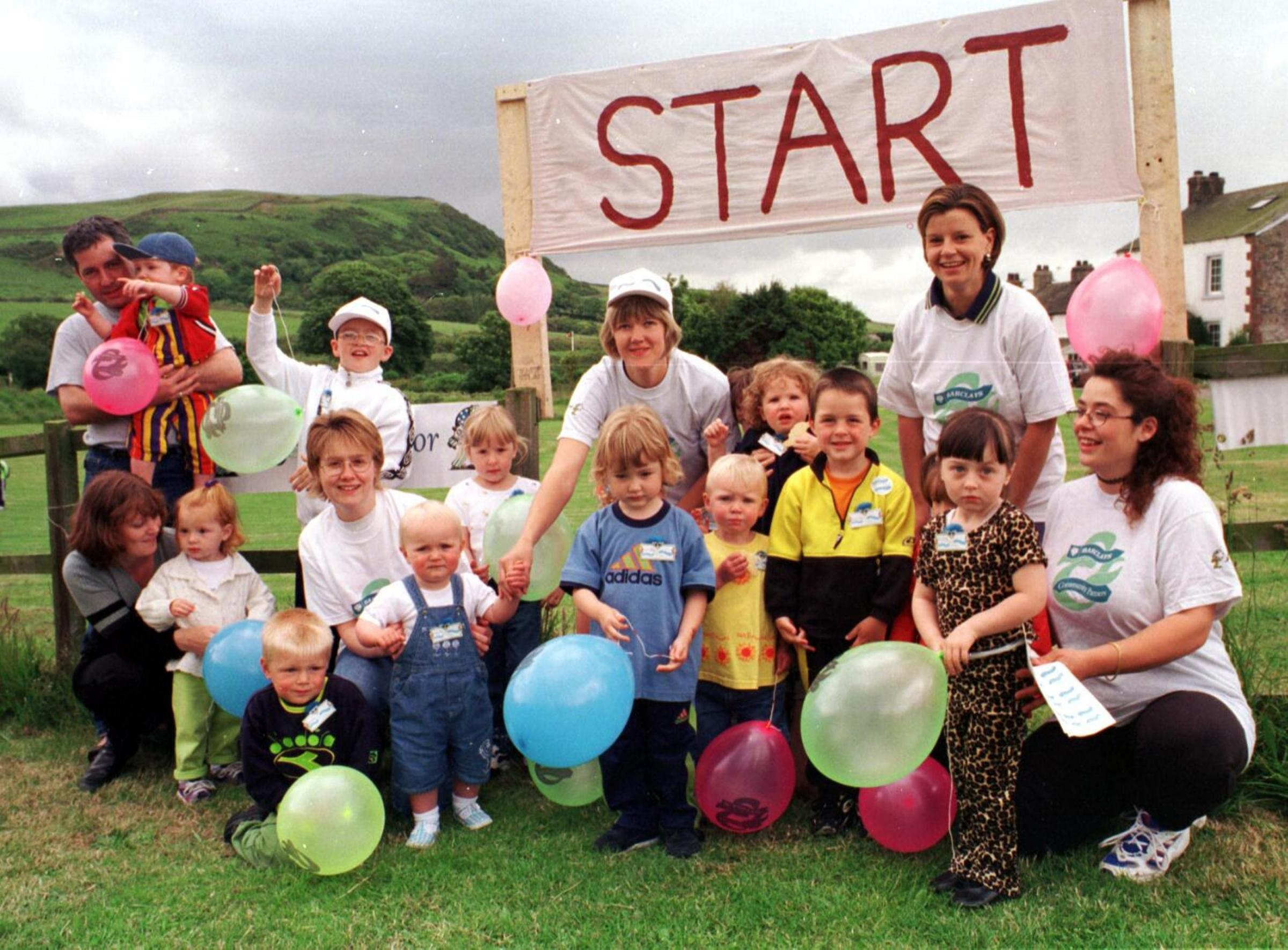 Event: Mothers with their children, ready to start the Toddlerthon at a June 1999 open day for Silecroft and Kirksanton playgroup