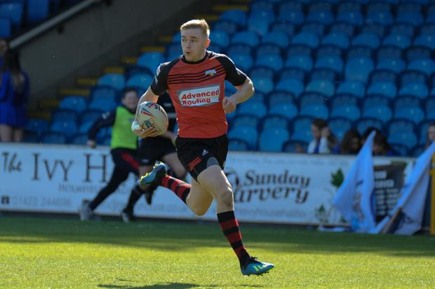 DEFIANCE: Jake Spedding races clear to score Barrow's first try