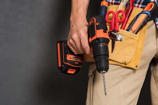 A generic photo of a man holding a drill with a toolbelt, See PA Feature NOSTALGIA DIY. Picture credit should read: iStock/PA. WARNING: This picture must only be used to accompany PA Feature NOSTALGIA DIY..