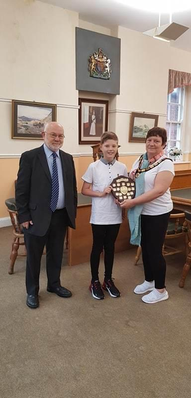 "AWARD: The mayor of Millom has presented a young boy with a bursary award. Millom mayor Angela Dixon presented Kai Nicholas with the South Cumbria Musical Festival Millom Bursary Award. Kai was awarded the bursary for being ""the most promising compe"