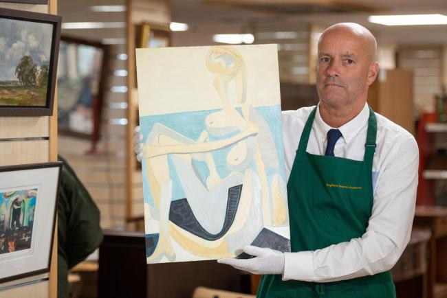 Andrew Potter holding The Seated Bather a 'PICASSO' painting bought for £230 at a car boot sale goes under the hammer today and could fetch as much as £1m, Brighton, East Sussex, 7th June 2019