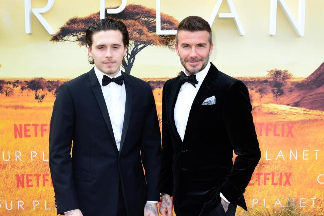 Brooklyn Beckham, left, and David Beckham, as the former football star revealed fatherhood had changed him 'in so many different ways'